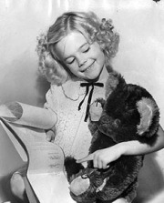 Natalie Wood shows her contract to her bear